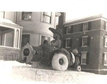 vintage photo Giant Snow Sculpture Man in CAr