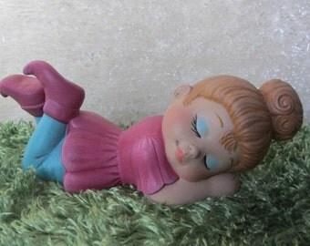 Pixie Girl lying down sleepy