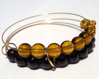 Pumpkin abacus bracelet in orange and black glass