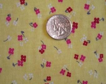 Ditsy flower on pretty yellow cotton jersey knit fabric 1 yard