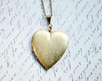 Vintage heart locket necklace, long chain, textured brass, keepsake jewelry