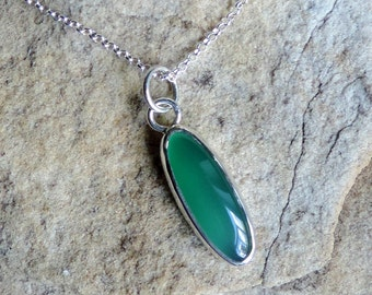 Sterling silver pendant with tall green agate cabochon on a chain