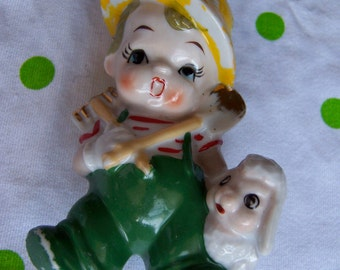 little boy and lamb figurine
