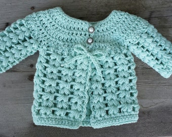 Crochet baby girl cardigan with pearl button top size 0 to 3 mo.