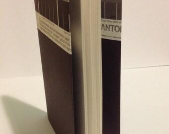 Small dark purple PANTONE notebook
