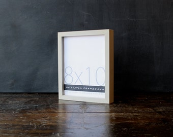 8x10 picture frame with natural sand colored finish part of Drift Collection . 8x10 handmade picture frame .