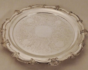 Silverplate CHIPPENDALE TRAY Round  Relief Embossed Thee ornate feet app 13 in diam by 1 1/4 in tall Wedding gift