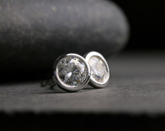 Large bezel set round brilliant cut Moissanite and sterling silver stud earrings 5mm one carat tw