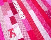 "Lap Quilt, Red and Pink or your favorite colors, Strip Quilt, Scrap Strip Quilt, machine stippling, 44""x50"", flannel backing"