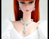 Beautiful Y Necklace with Turquoise Swarovski Crystal and Crystal Flower shaped Pendant.