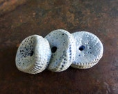 Grungy wheels. Large textured polymer rings.
