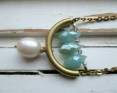 Suspension necklace, faceted aqua crystal briolette, freshwater pearl and brass charm necklace, bridesmaid accessory
