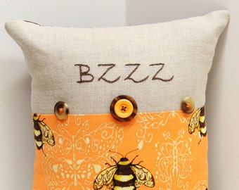 "Bee pillow- hand  embroidered on linen with bumblebee print- 'BZZZ"", embellished with buttons"