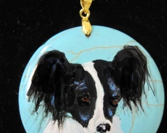 Handpainted necklace of a cute papillion dog
