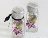 Salt and pepper shakers that are hand painted in a floral purple daisy design- Dishwasher safe.