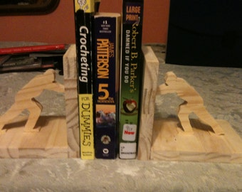 Wooden men pushing bookends
