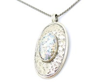 Oval silver pendant with roman glass in the center