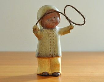 UCTCI Japan stoneware child figurine with jump rope