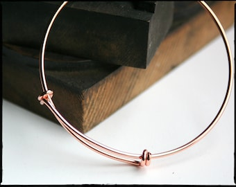 5-pack Rose Gold expandable bangle bracelet. Adjustable wire. Qty 5. For stacking, charm bracelets. Bracelet blanks. Jewelry supplies.
