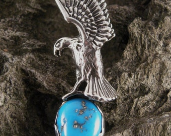 PENDANT STERLING SILVER,  Flying Eagle Sterling Silver, approx 10 mm Turquoise Cabochon, Pendent is 40 mm high and 14 mm wide.