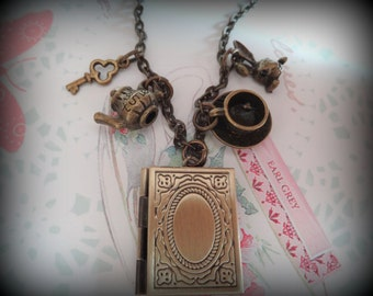 Follow Me. Alice in Wonderland inspired rabbit and book locket necklace. Bronze Tone. VIntage Style.