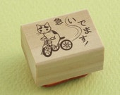 """Japanese Cat Wooden Rubber Stamp - Cat Riding Bicycle - """"URGENT"""" - Pottering Cat"""