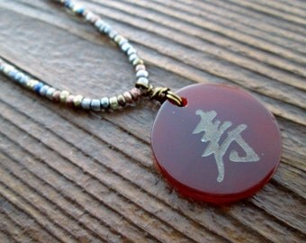 "seed bead necklace with carnelian Chinese ""longevity"" pendant"