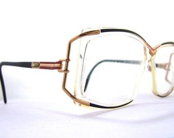 Popular items for designer eyeglasses on Etsy