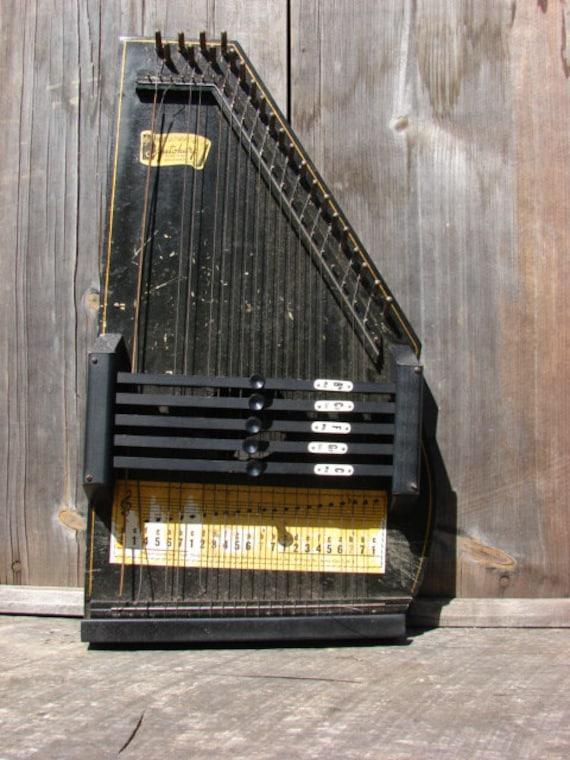 Autoharp likewise MAR 2009 in addition B3NjYXIgIHNjaG1pZHQ furthermore B3NjYXIgc2NobWlkdCBjb21wYW55 moreover Antique Autoharp. on oscar schmidt autoharp logo