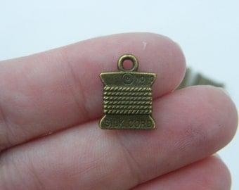 8 Spool  charms antique bronze tone BC173
