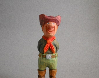 Wood hand carved miniture cowboy figure