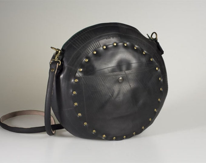 Designer innertube round handbag. Ethical, Recycled, rubber, black. Waterproof Eco fashion.