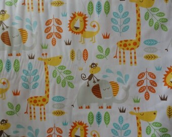 A Safari with a Giraffe, Lion, Elephant, Monkey in a jungle cotton fabric quilting & sewing
