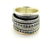 Wide spinner ring with Spinel & Zircon stones