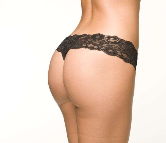 This sexy panty features a sheer black and white lace panel, a triple strapped waistband, and a thong cut back. (Bra not included.).