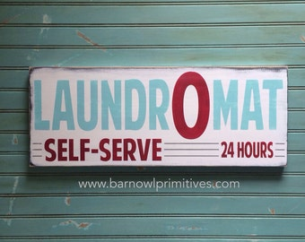 Laundromat Distressed Sign in Weather Worn White with Hummingbird Blue, Crimson and Grey