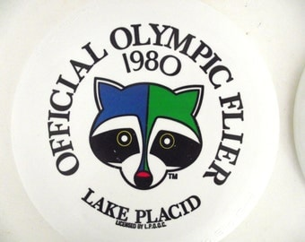 Pair of 1980 Lake Placid Olympics Winter Games, Frisbees, Olympic Fliers