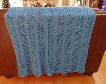 HAND KNITTED AFGHAN: Full size,, bright blue, knitted in a feather and fan pattern stitch, worsted weight acrylic yarn