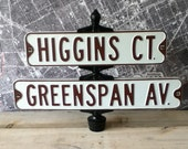 Street signs vintage on iron stand Actual sign Higgins Greenspan