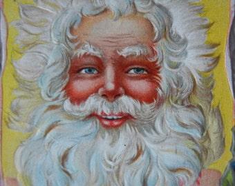 Vintage Santa Postcard christmas card colorful and embossed