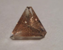 faceted Oregon Sunstone ...........  7 mm x 4 mm tall ......  a4581