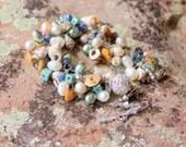 beach texture bracelet / pearls / howlite / sodalite / faceted crystals / nutmeg seashells / healing calmning psychic gemstones
