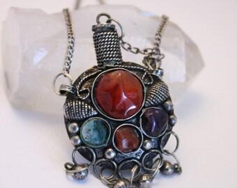 Vintage bottle pendant necklace. Gemstone cabochons.