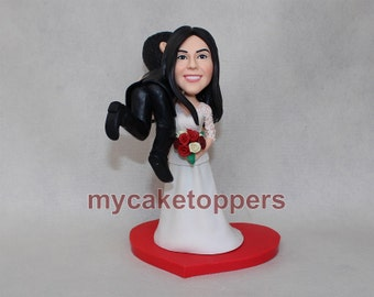 customized wedding cake topper, wedding, hand made, bride carrying groom, carry, funny, fun, lovely cake topper