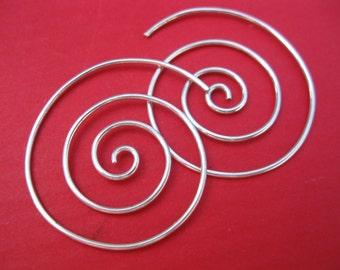 Sterling silver sacred spiral swirl earrings.