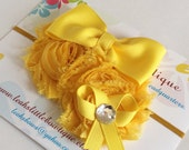 Yellow Flower Bow Headband:  yellow grosgrain bow and flower cluster attached to a skinny gold elastic headband