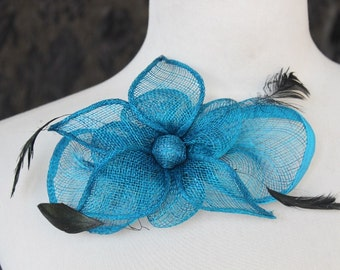 Cute  blue   color    flower  with feather  clip  back 1 piece listing big size