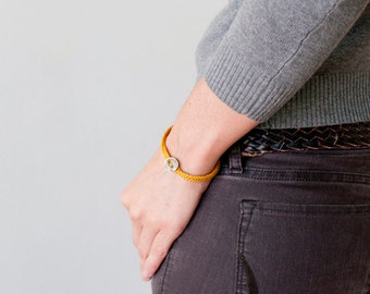 Friendship bracelet. Coiled Bracelet. Threaded Bracelet. Crochet Bracelet · Textile jewelry. Yellow · Crocheted jewelry