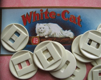 Vintage Ivory Plastic Buttons...large...art deco...looks like bakelite...but not...1930..lot of 10