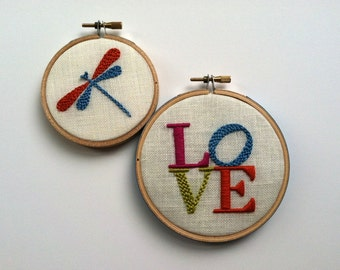 LOVE & Dragonfly.  hand embroidery.  hoop art.  home decor.  wall wear.  magenta. aqua.  citrine.  orange.  hand embroidered by mlmxoxo